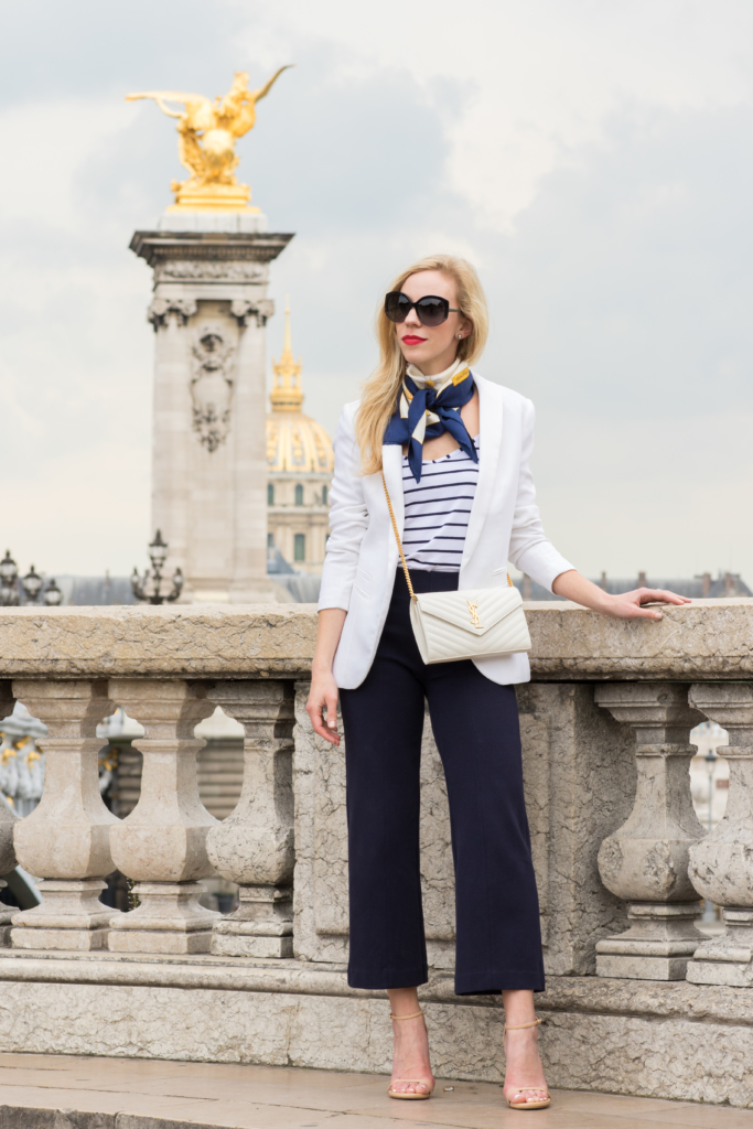 white blazer with navy and white striped camisole, navy culottes, Ferragamo silk necktie scarf, how to wear a necktie scarf, Parisian style, white blazer with navy pants outfit