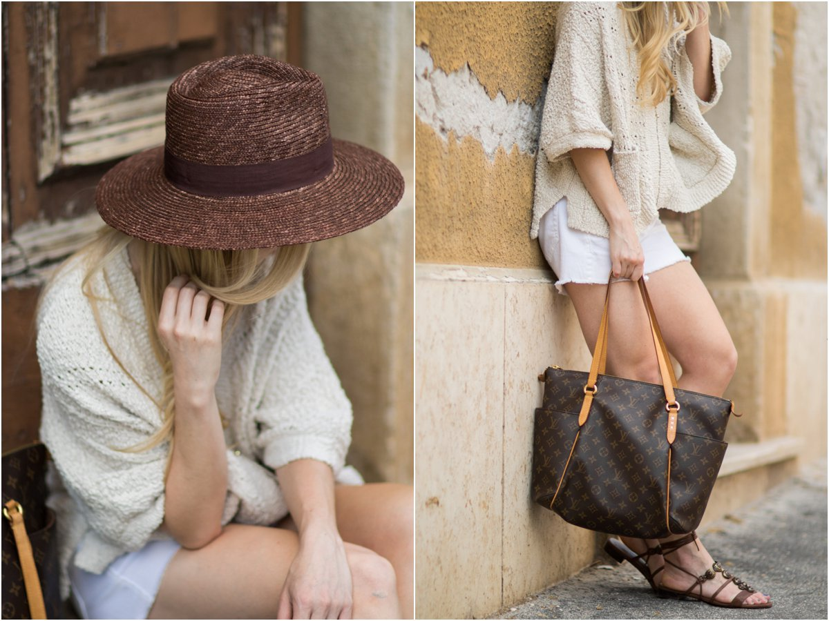 Brixton 'Joanna' brown panama hat, beige poncho sweater with white denim cutoff shorts, Louis Vuitton Totally MM monogram tote
