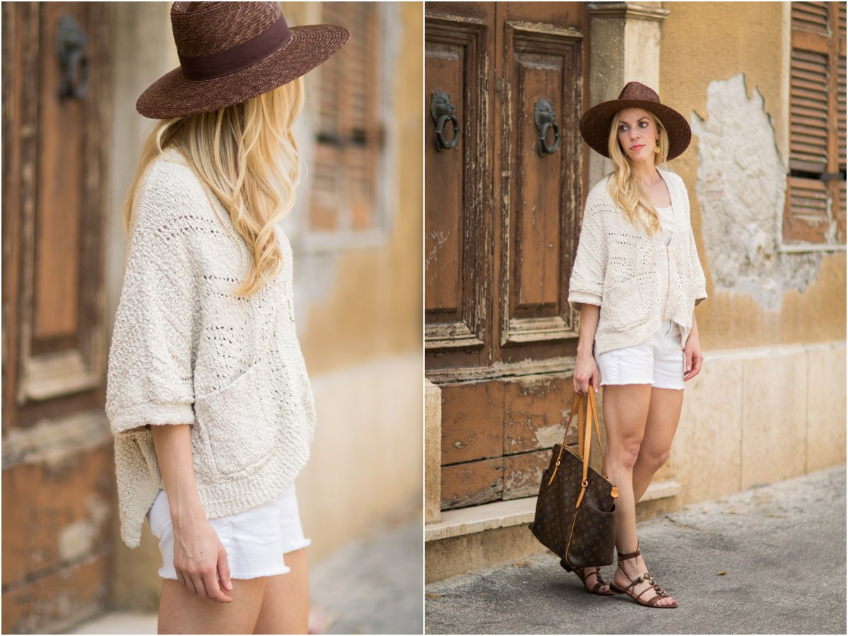 Intropia beige poncho sweater, white cutoff denim shorts, Brixton 'Joanna' brown panama hat, beige sweater and white denim neutral summer outfit