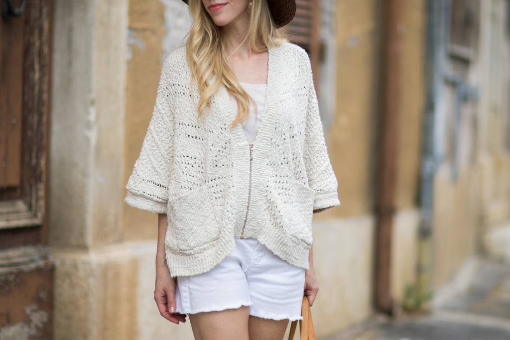 Intropia zip front poncho, beige poncho with white denim cutoff shorts