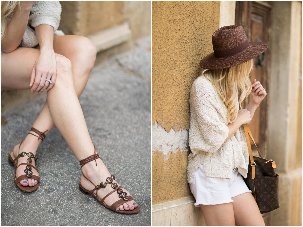 Stuart Weitzman 'Stoned' embellished lace-up sandals, Brixton 'Joanna' brown panama hat, beige poncho sweater with white cutoff shorts