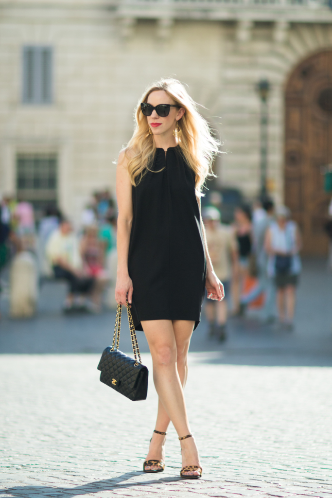 black trapeze dress with leopard print sandals, Chanel black classic flap bag, little black dress with leopard heels and Chanel bag