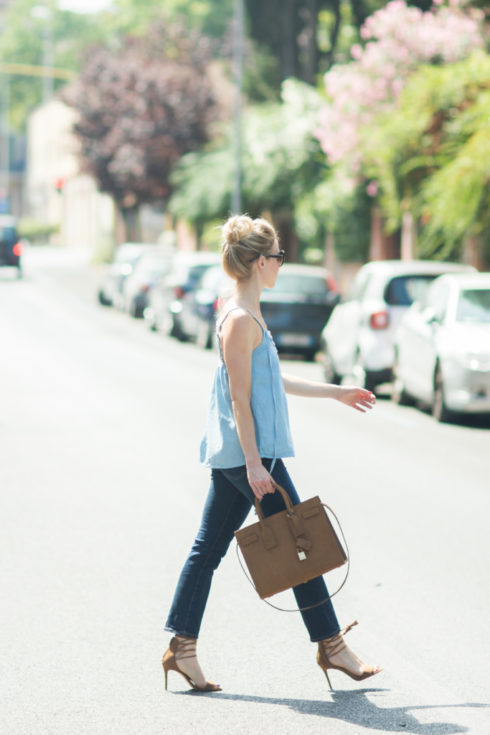 chambray top with dark denim jeans, AG Jeans Jodi crop flare, Saint Laurent small sac de jour brown suede, kick crop flares with lace up sandals
