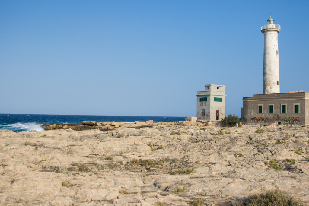 lighthouse in Faro di Augusta Sicily, travel blogger in Italy