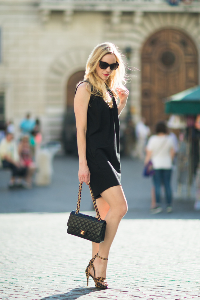 sleeveless black trapeze dress, Chanel classic flap bag, Joie leopard print sandals, fashion blogger Rome Italy