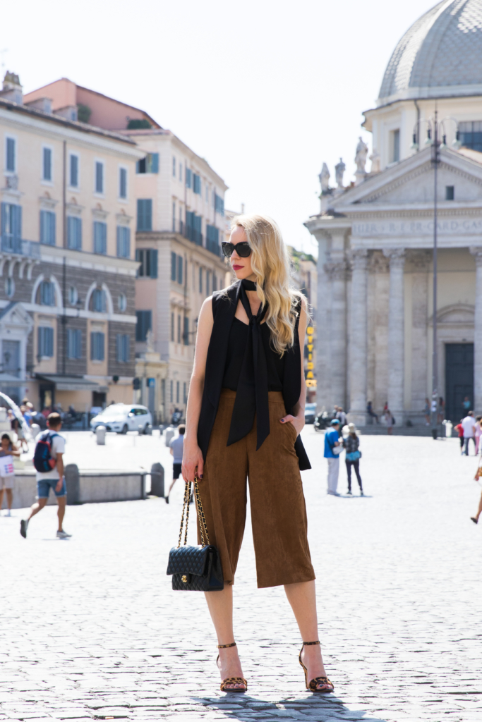 black skinny scarf, long black vest, Old Navy suede culottes, leopard print sandals, Chanel classic flap bag black lambskin gold hardware, skinny scarf outfit