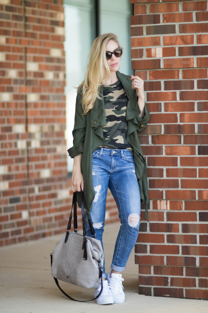 camo print tee with utility jacket and distressed denim, how to wear camouflage and look stylish, drapey utility jacket outfit