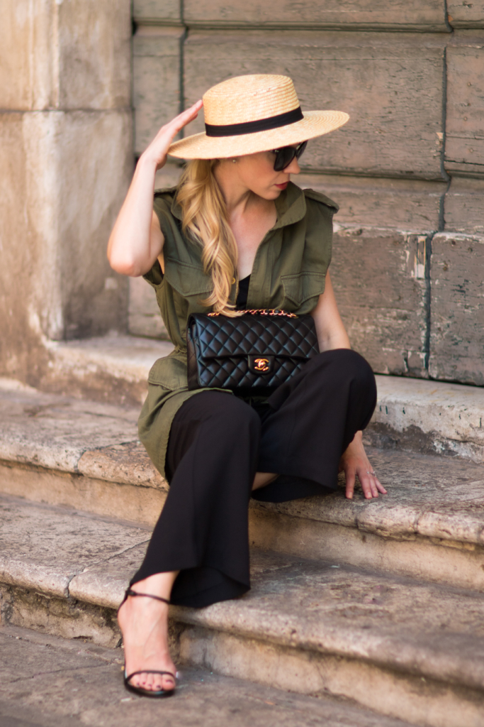 chic way to wear an olive utility vest, olive utility vest with culotte jumpsuit, how to wear a straw boater hat