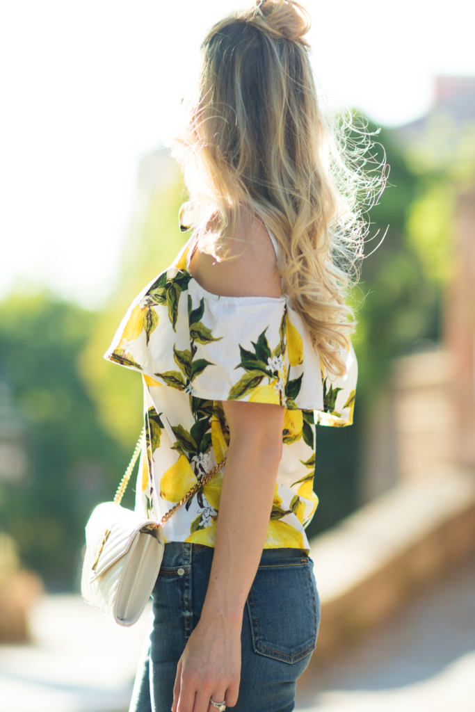 cold shoulder lemon print top, how to wear the half bun hairstyle, off the shoulder top with half bun