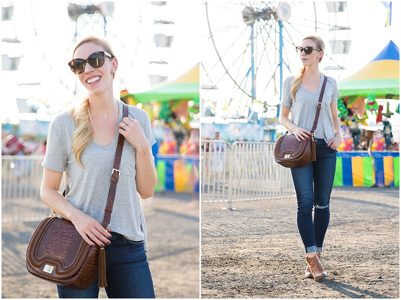 gray v-neck tee with distressed denim, tan saddle bag, casual outfit with booties and ripped jeans