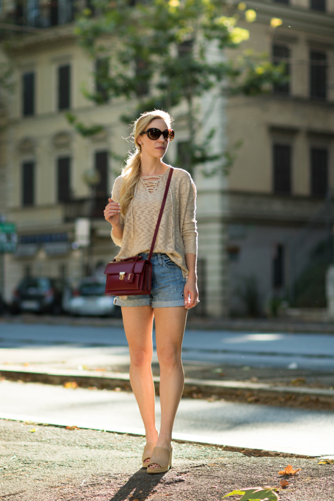 lace-up sweater with high waist boyfriend shorts, mule wedge sandals, Saint Laurent High School satchel, how to wear lace-up shirt