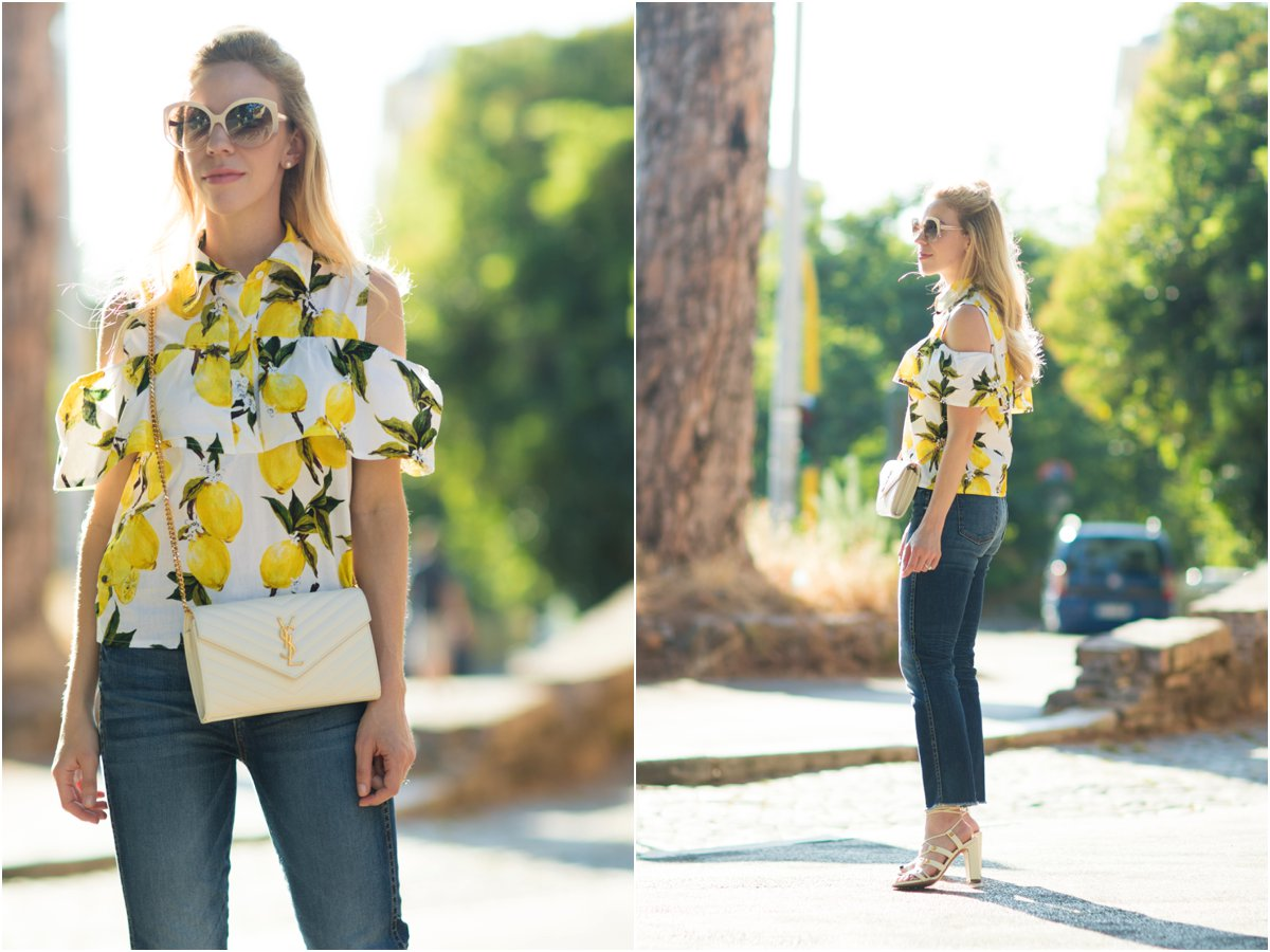 off the shoulder lemon print top with high waist jeans, YSL white monogram matelasse wallet, lemon print summer outfit
