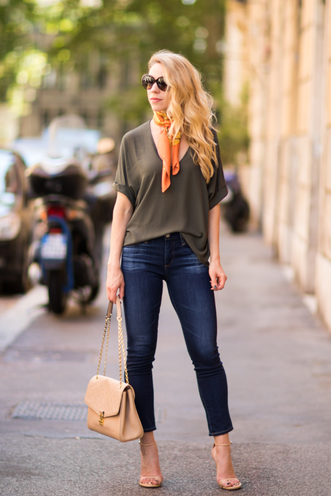 olive drapey oversized tee with silk scarf, AG Jeans Prima Crop, Stuart Weitzman Nudist nude stilettos, Louis Vuitton St. Germain bag dune, silk scarf with tee shirt outfit