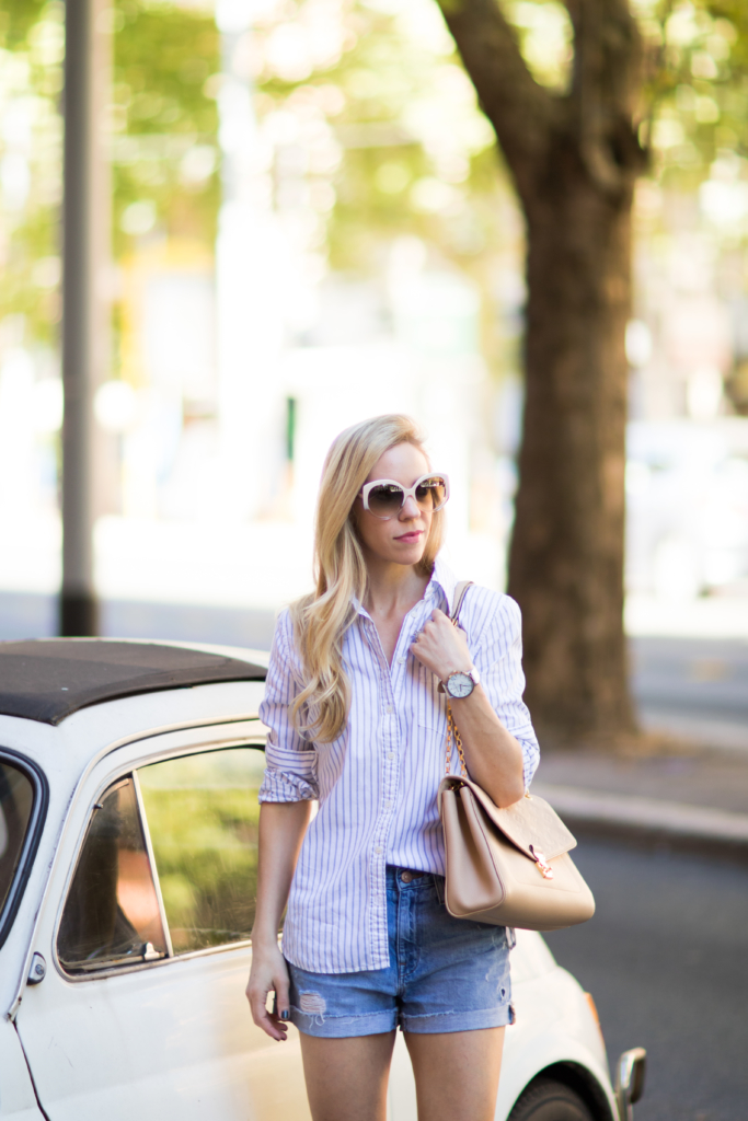 striped shirt with distressed denim shorts, classic outfit with striped button down shirt and denim shorts, Louis Vuitton St. Germain monogram bag beige