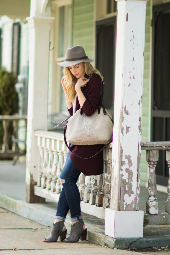 burgundy-and-gray-fall-outfit-brahmin-delaney-tote-smoke-wilmington-oversized-cardigan-with-distressed-denim
