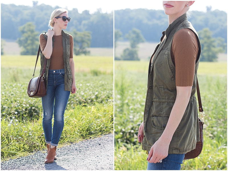 olive utility vest with camel sweater, utility vest outfit with distressed denim and booties fall outfit