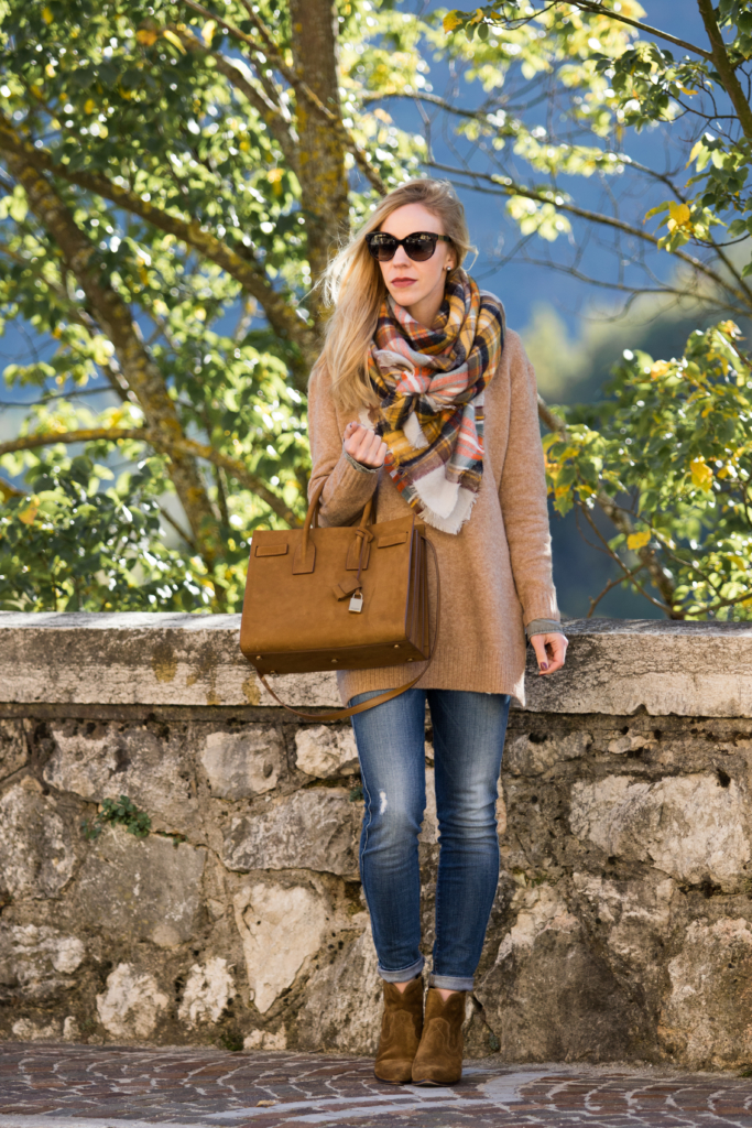 plaid-blanket-scarf-with-camel-sweater-and-booties-saint-laurent-tan-suede-sac-de-jour-a-unique-way-to-tie-a-blanket-scarf
