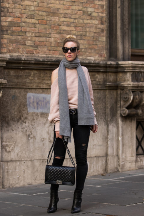 off-the-shoulder-sweater-with-oversized-scarf-black-distressed-jeans-chanel-boy-bag-black-and-brushed-metal