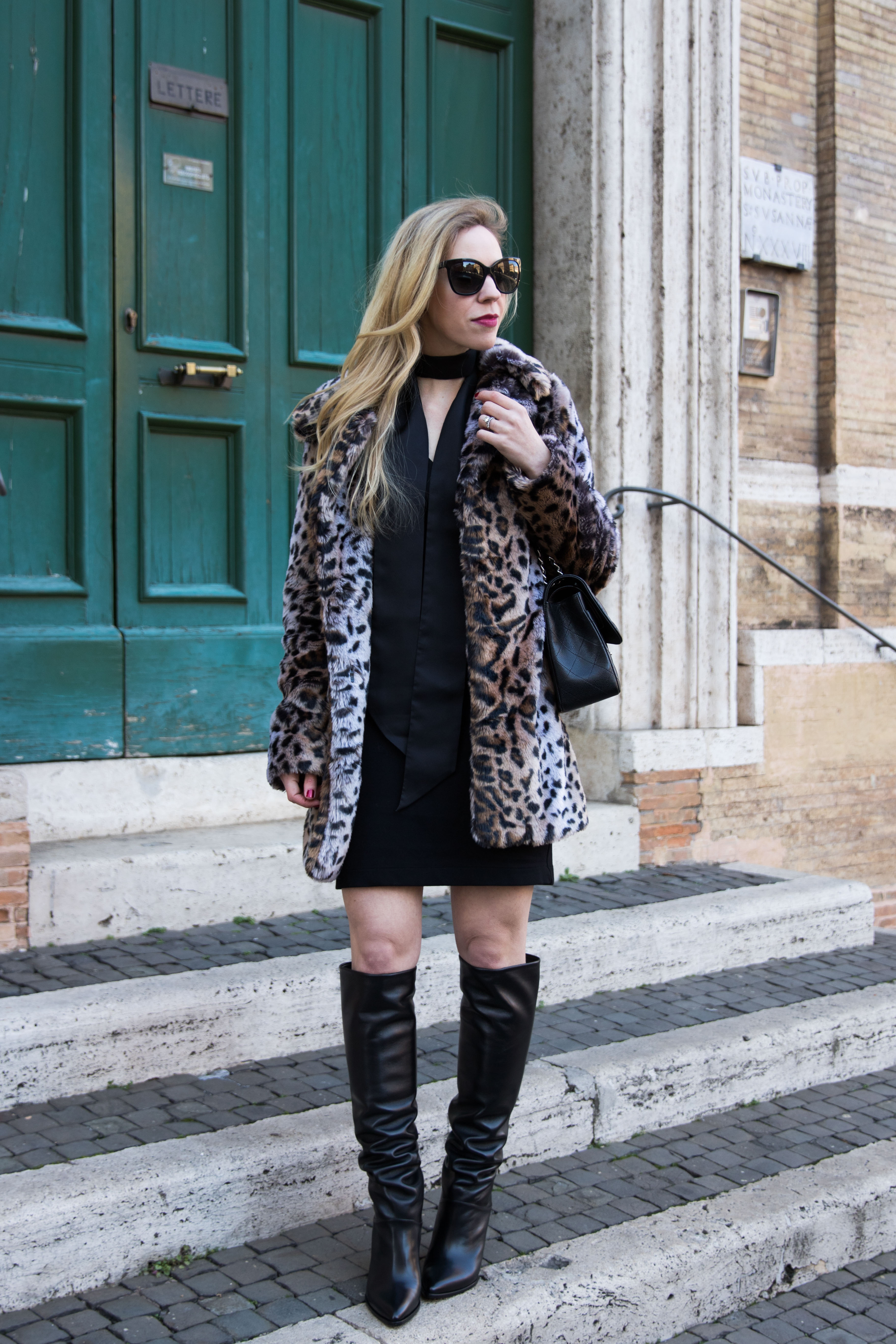 fashion-blogger-wearing-faux-fur-leopard-coat-with-black-dress-and-black-skinny-scarf-stuart-weitzman-scrunchy-knee-high-leather-boots