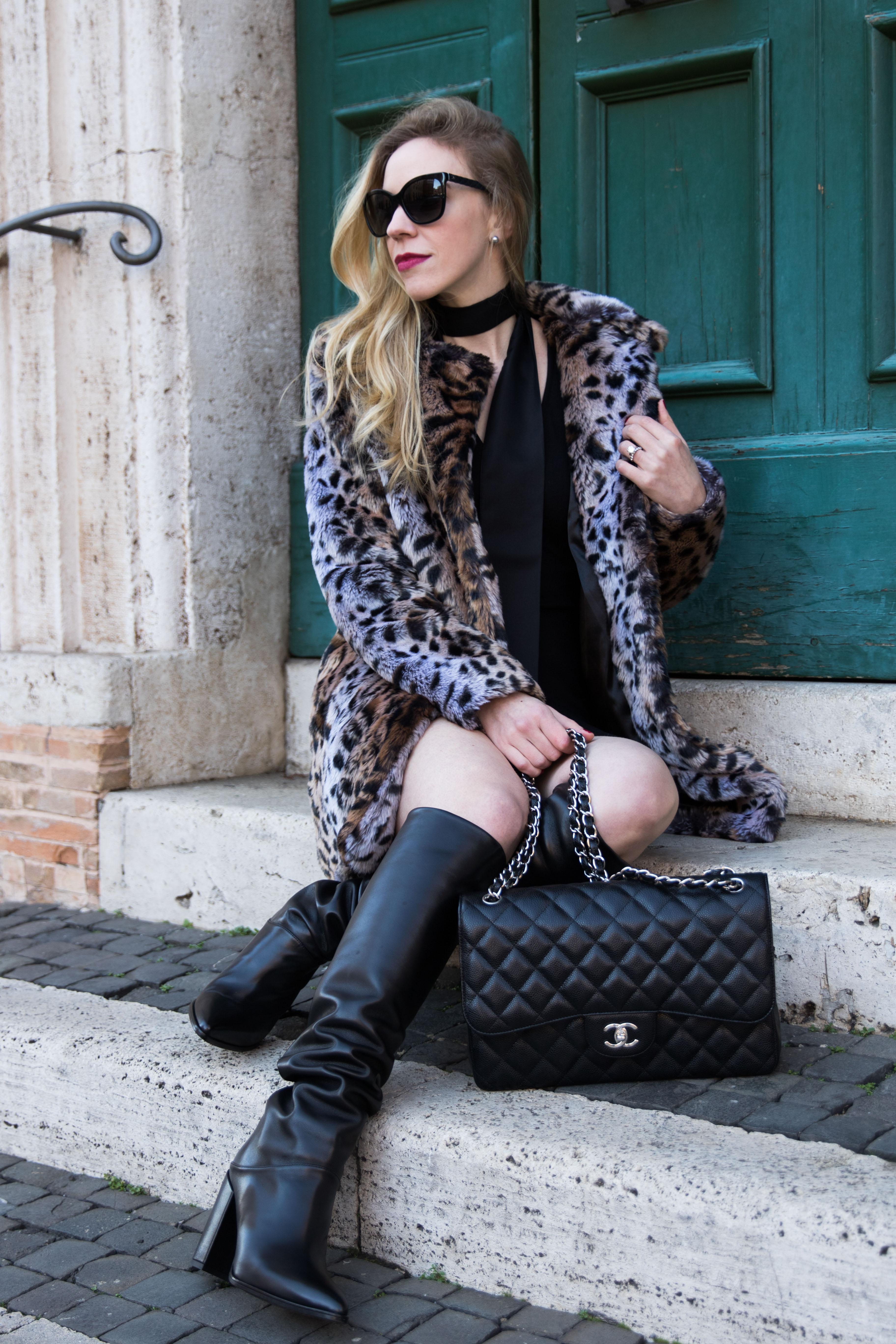 fashion-blogger-wearing-faux-fur-leopard-coat-with-black-dress-and-knee-high-boots-stuart-weitzman-scrunchy-black-leather-boots-chanel-jumbo-black-caviar