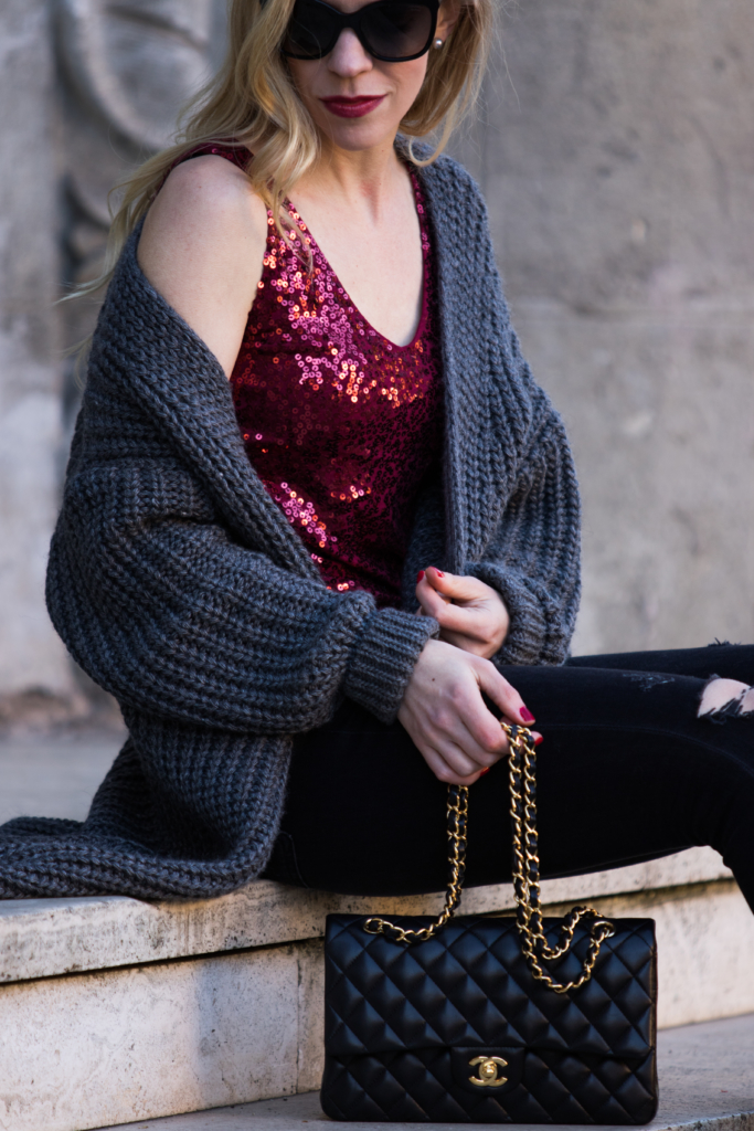 oversized-gray-cardigan-sweater-with-red-sequin-top-new-years-eve-outfit-with-sweater-and-sequin-top-chanel-medium-classic-flap-bag-black-and-gold
