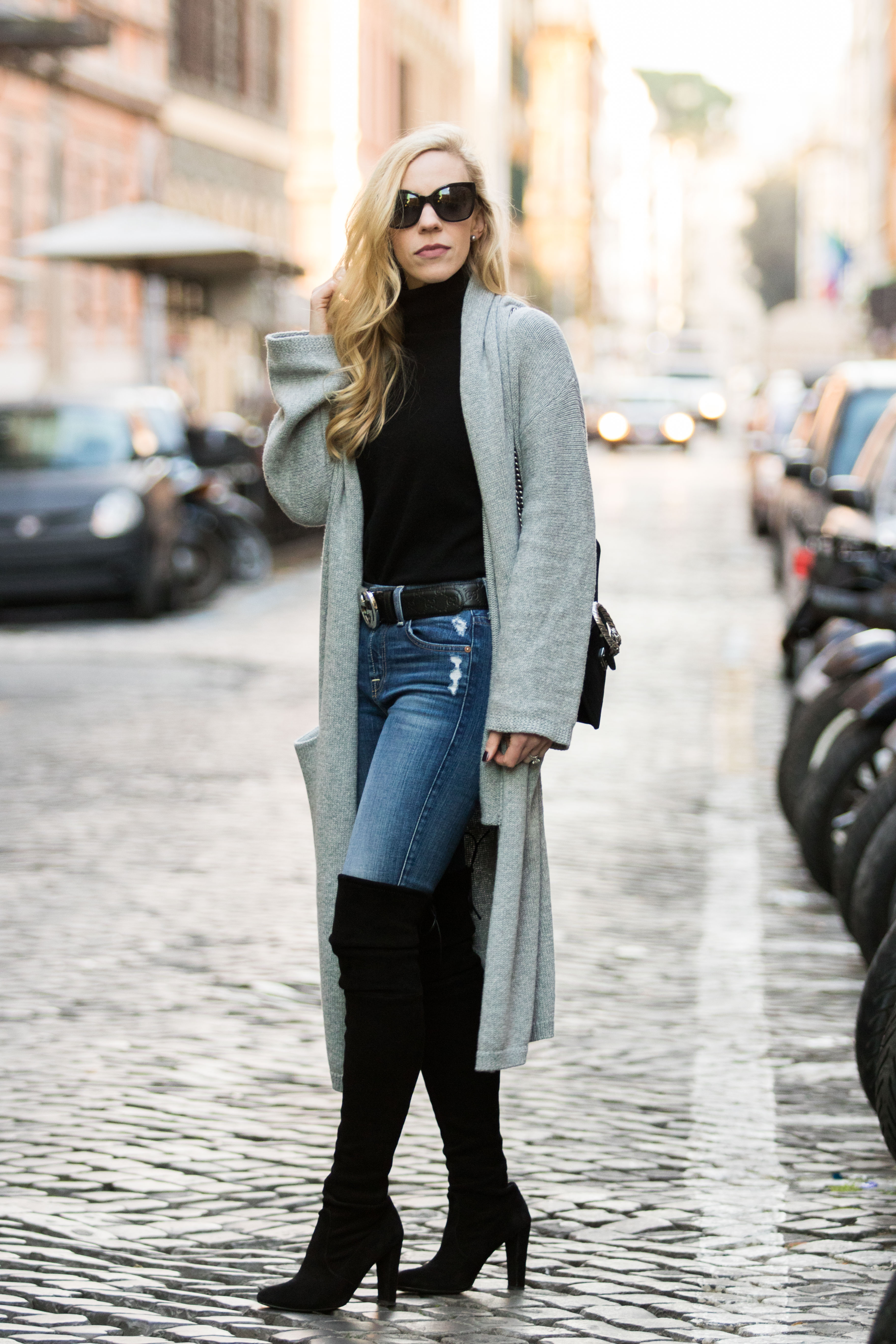 Meagan Brandon fashion blogger in long maxi cardigan with turtleneck and Stuart Weitzman over the knee boots