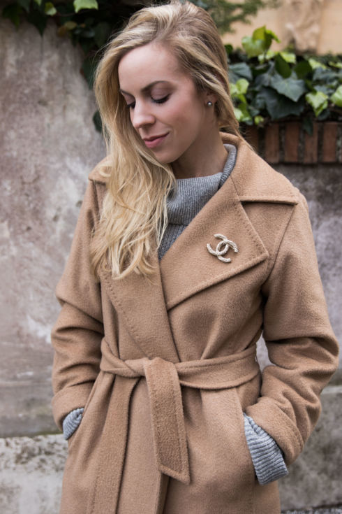Meagan Brandon fashion blogger shows how to accessorize a winter coat, different ways to accessorize a coat, Chanel brooch pin camel coat