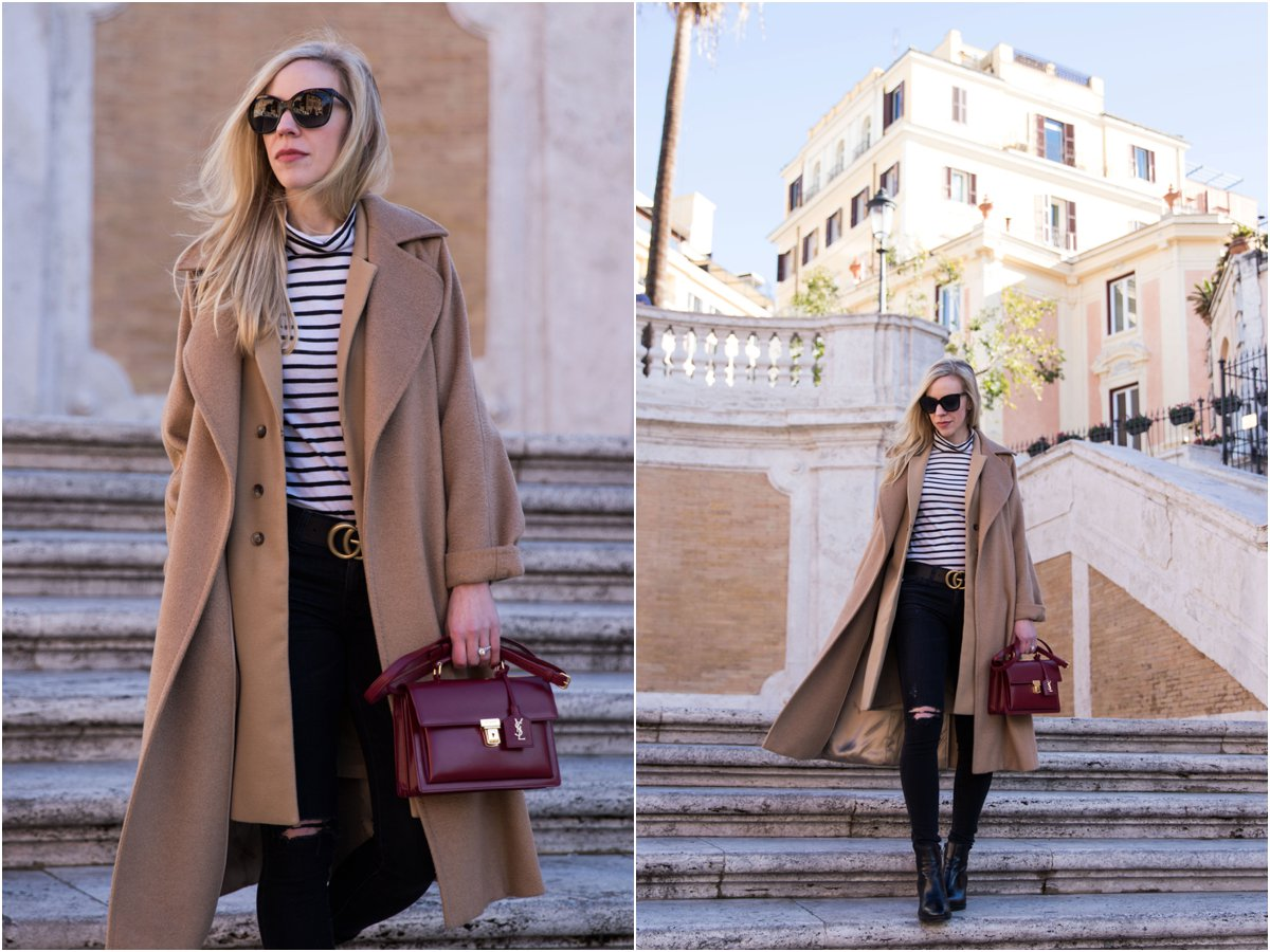 Meagan Brandon fashion blogger shows how to layer camel coat with vest, striped shirt and black jeans