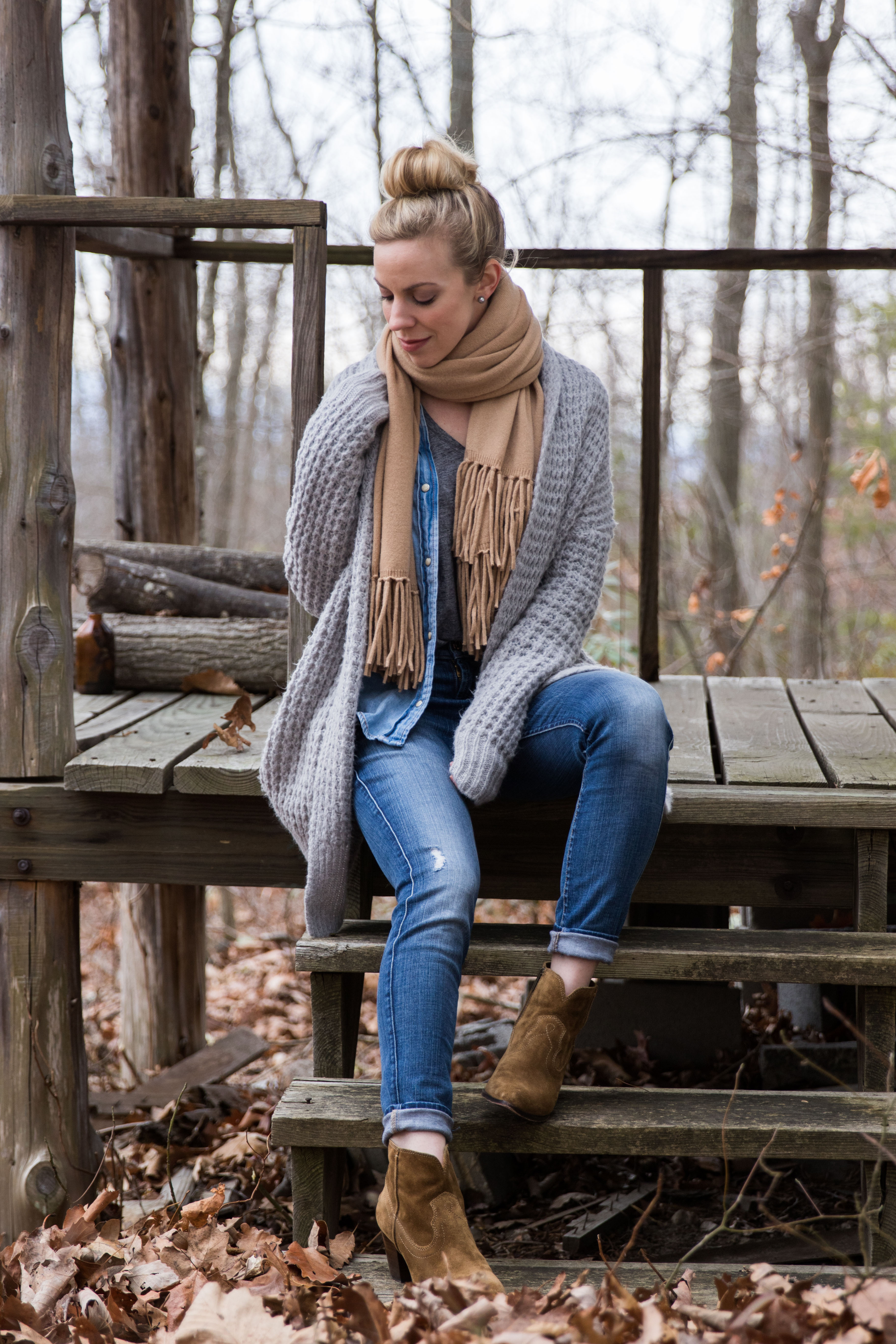 Meagan Brandon fashion blogger wear layers with waffle knit cardigan, camel scarf, denim shirt and suede booties