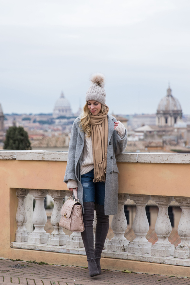 fashion-blogger-meagan-brandon-wearing-oversized-gray-boyfriend-coat-with-over-the-knee-boots-and-pom-beanie-hat-fashion-blogger-rome-italy