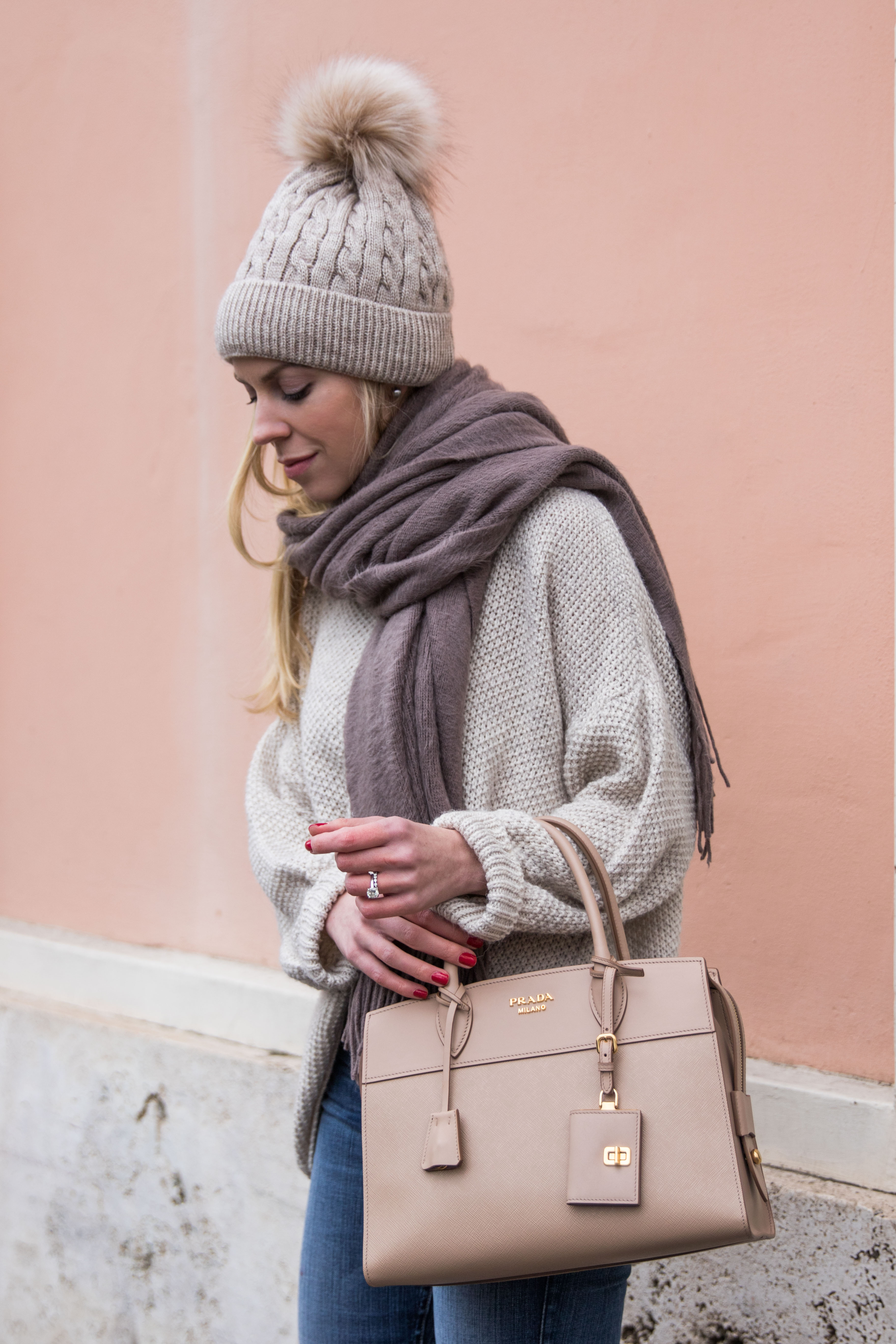 oversized beige sweater with gray scarf and pom hat, Prada Esplanade City tote cameo leather