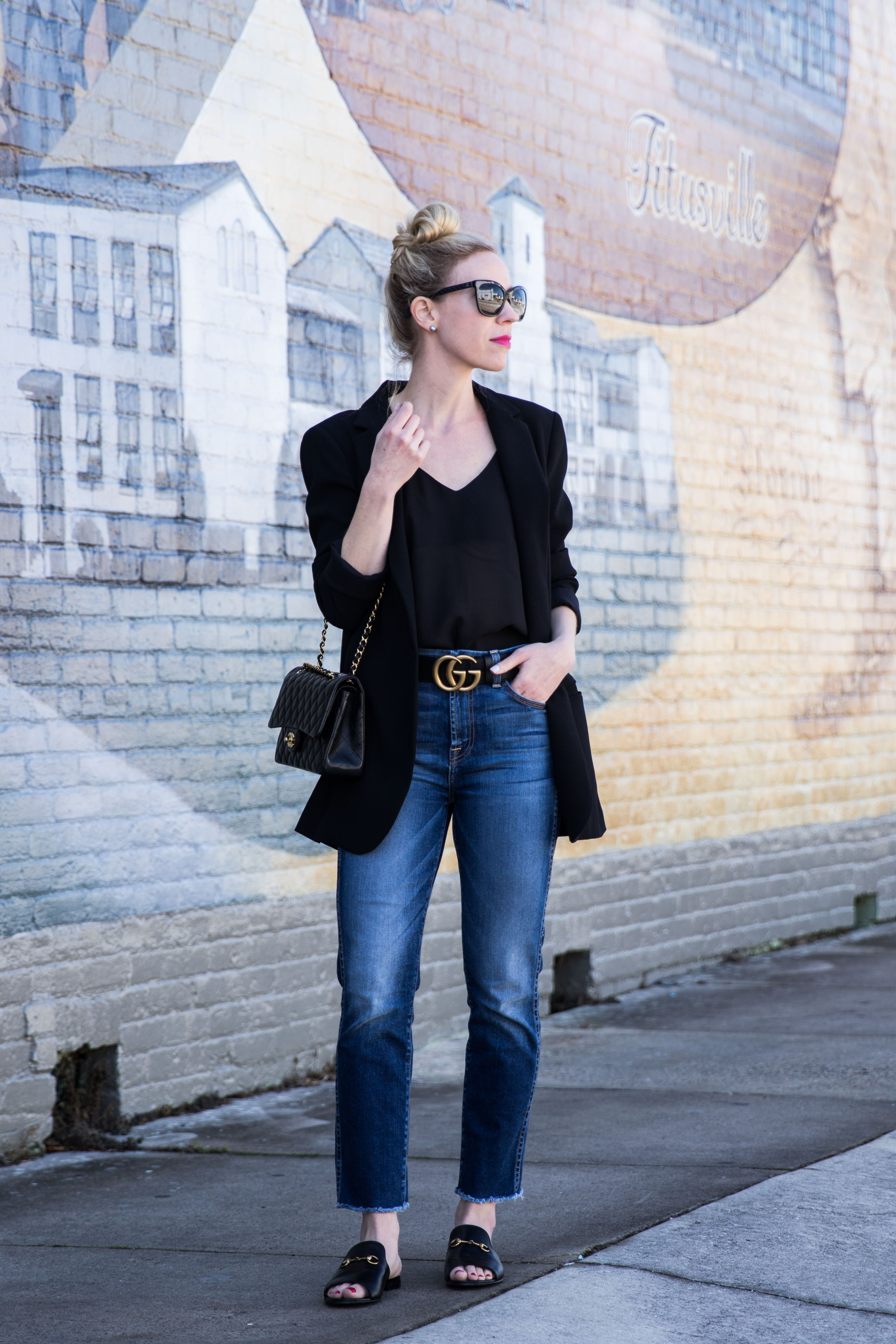 f0ccf3a8c6b Meagan Brandon fashion blogger wearing long black blazer with Gucci Marmont  belt and straight leg jeans with Gucci slide sandals