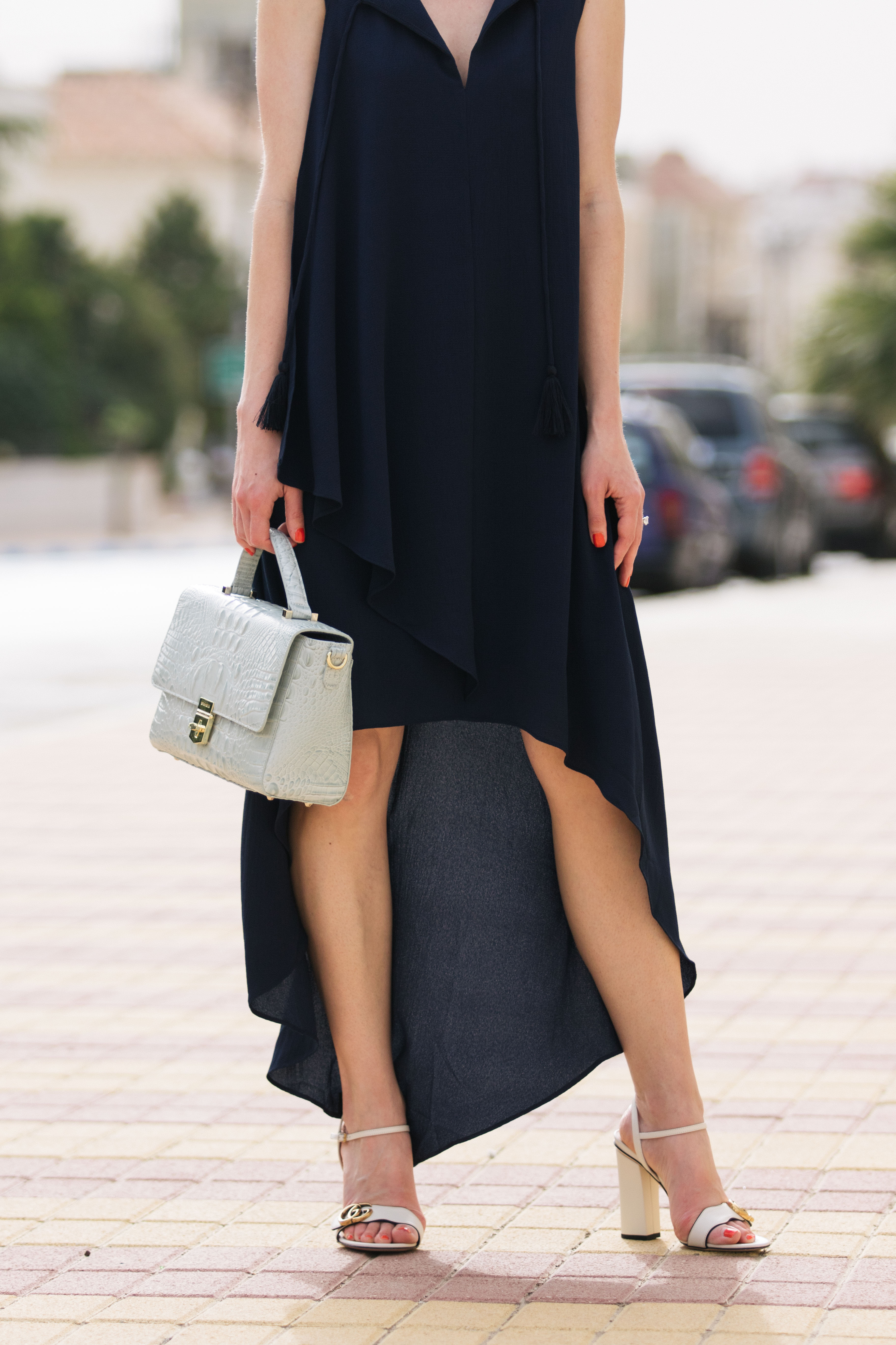 5ec27291e3a Adelyn Rae navy blue high low hem dress with Gucci Marmont white block heel  sandals