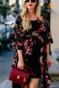 f8954bfc729 Meagan Brandon fashion blogger of Meagan s Moda wears dark floral print  kimono with Gucci belt and red Saint Laurent High School bag