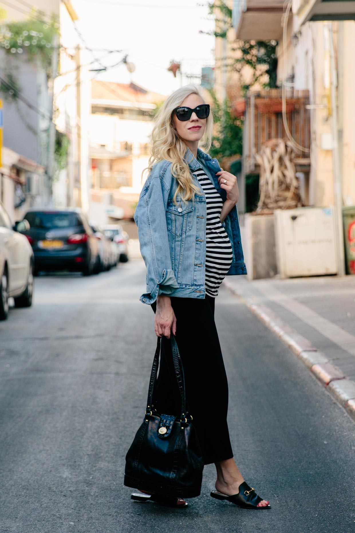 e63461881e0 Meagan's Moda fashion blogger wears Levi's Ex Boyfriend denim jacket with striped  tee and cropped wide leg pants, chic maternity outfit with Gucci loafers