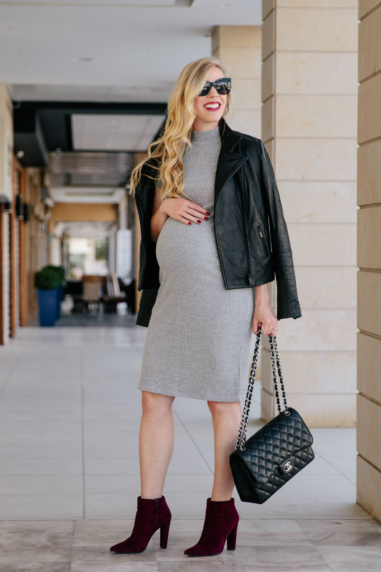 Edgy Maternity Outfit: Leather Jacket, Sweater Dress & Burgundy Boots