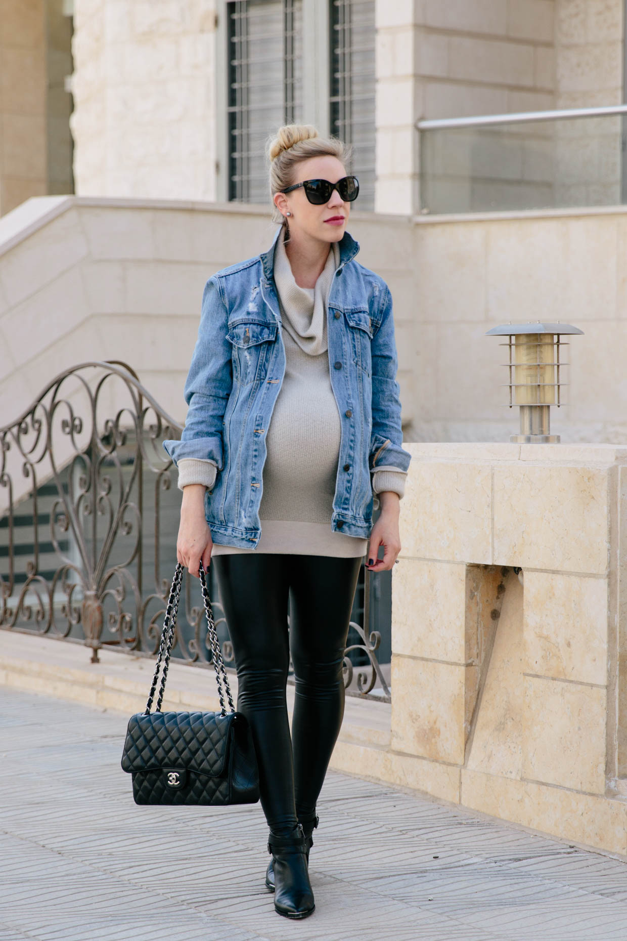 774c3391144ce Meagan Brandon fashion blogger of Meagan's Moda wears GAP oversized denim  jacket with Ingrid & Isabel sweater tunic, leather maternity leggings and  Marc ...