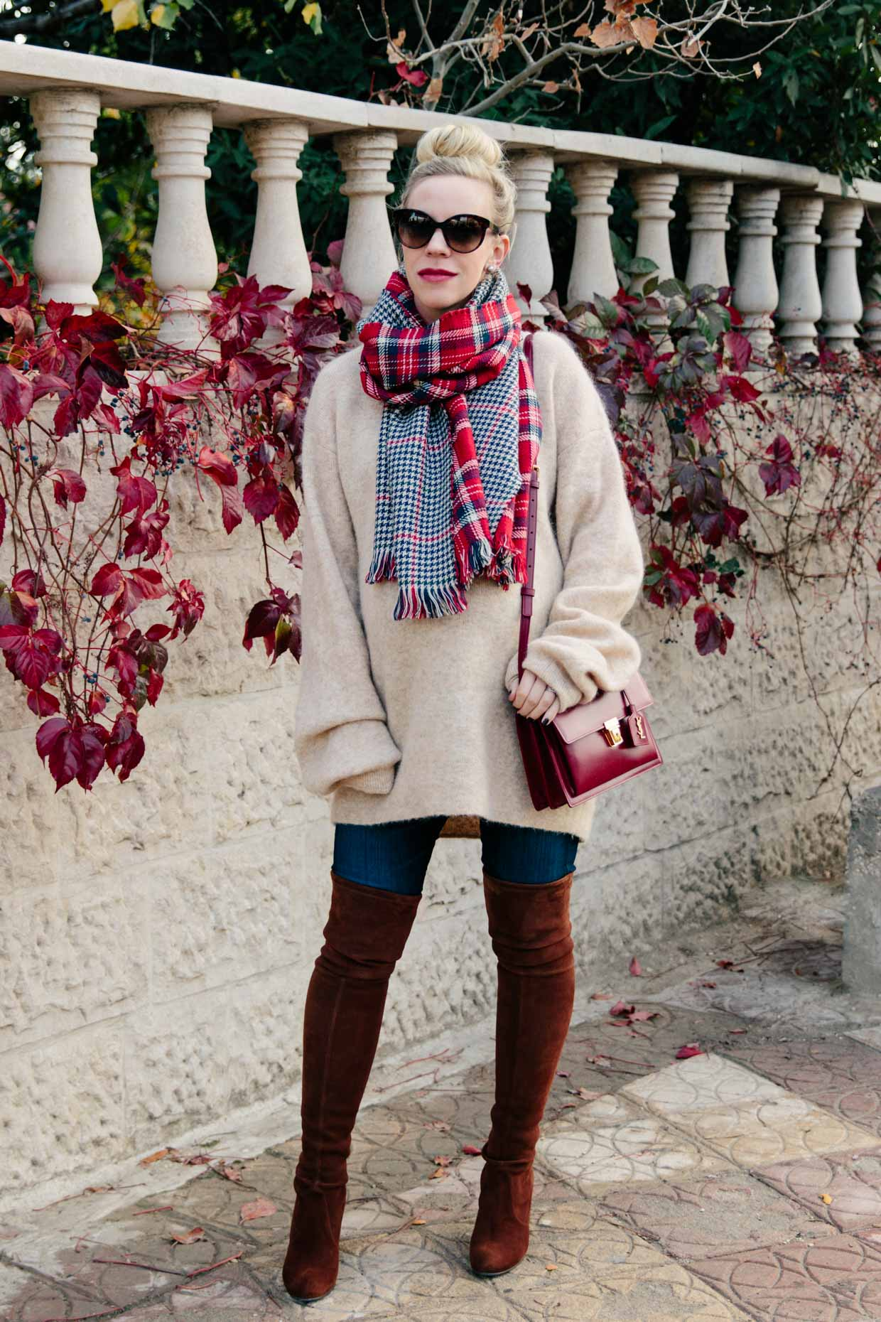 274fa4a709a Meagan Brandon fashion blogger of Meagan s Moda wears oversized sweater  with plaid scarf and over the knee boots maternity holiday outfit