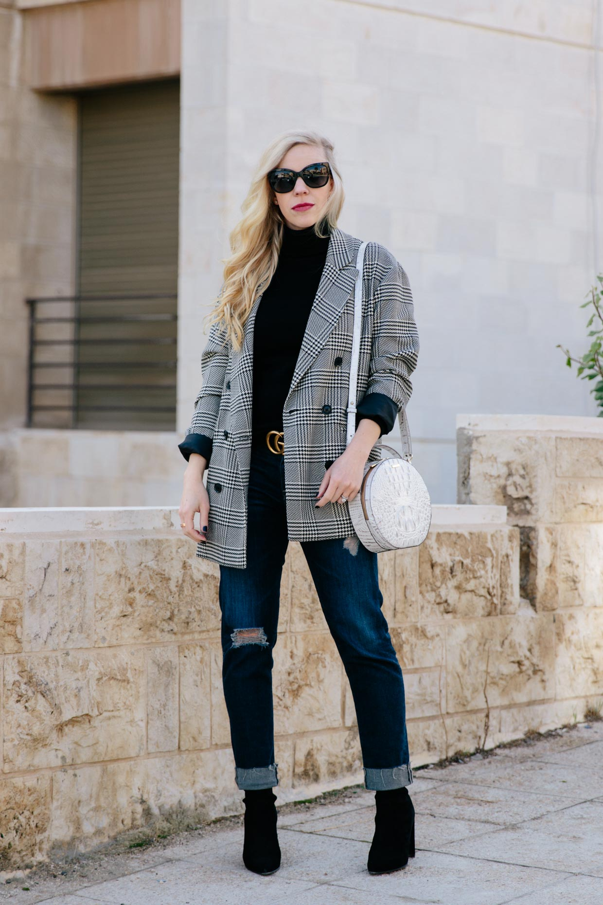 9902299ce0d Meagan Brandon fashion blogger of Meagan s Moda wears oversized menswear  checked blazer with distressed boyfriend jeans