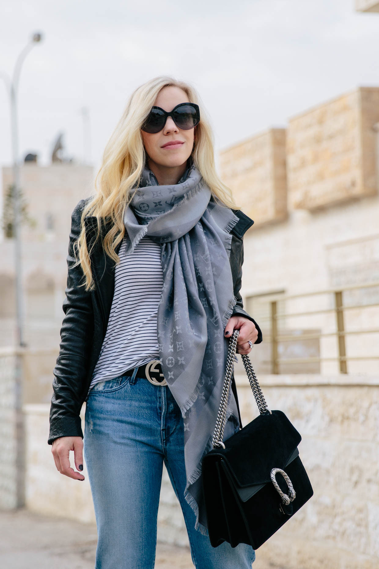 0cb9ae2da10 Meagan Brandon fashion blogger of Meagan s Moda wears black leather jacket  with striped tee