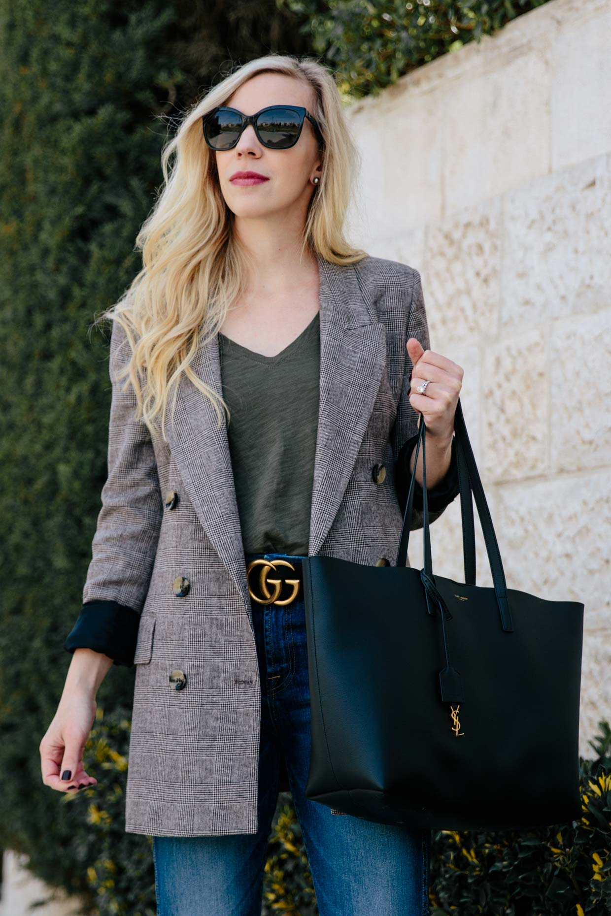 1204dc53f28 Meagan Brandon fashion blogger of Meagan s Moda wears oversized plaid  blazer with Gucci Marmont belt and straight leg jeans