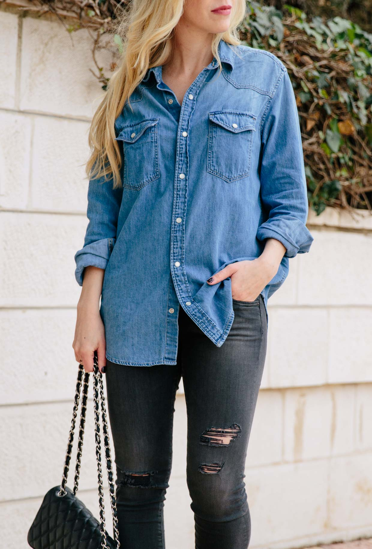 Outfit idea with denim shirt and black distressed jeans