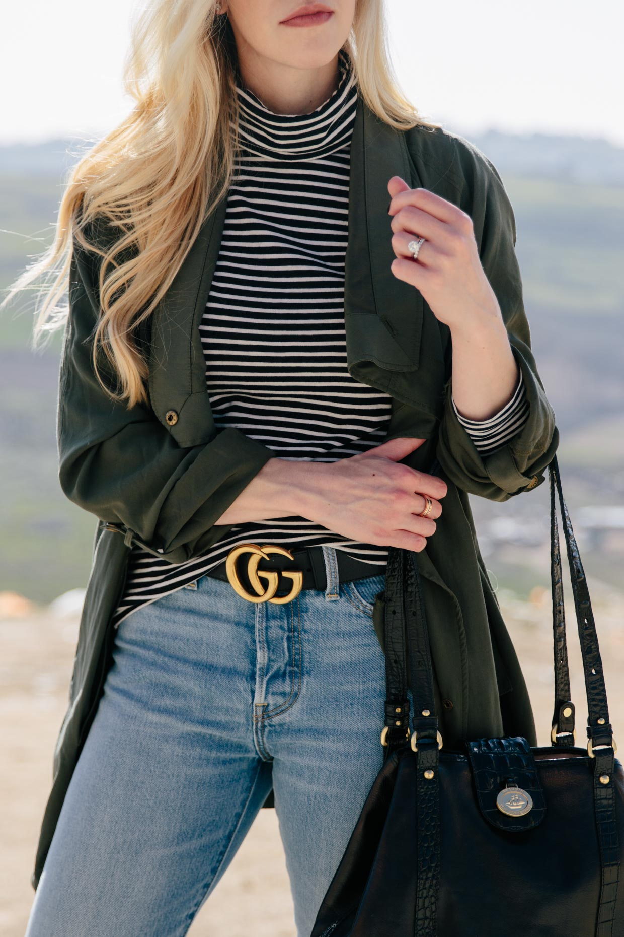 transitional spring outfit with olive jacket and striped turtleneck
