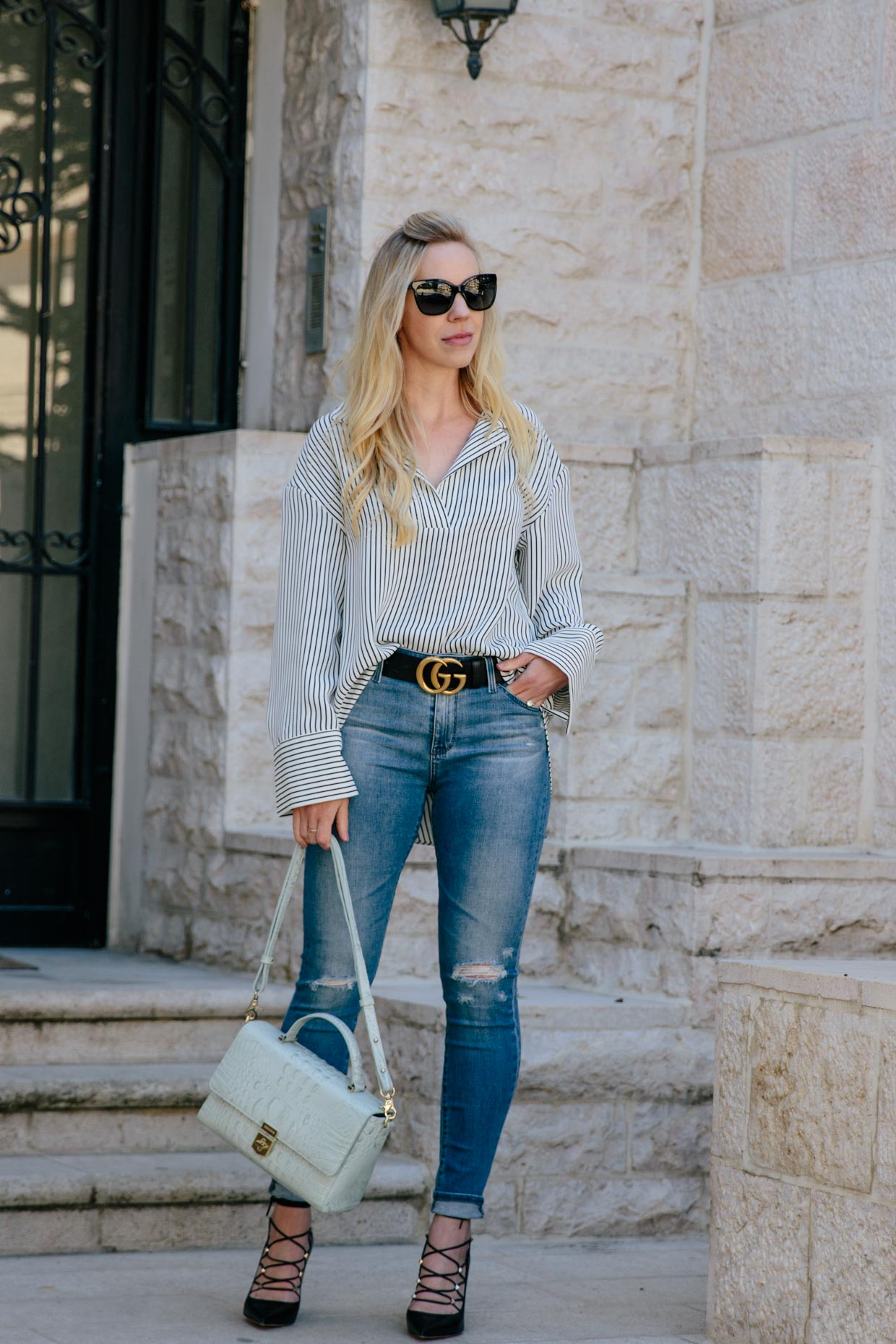 c1c3c961d2  s Moda wears oversized striped shirt with AG Farrah Ankle skinny jeans and  Gucci belt