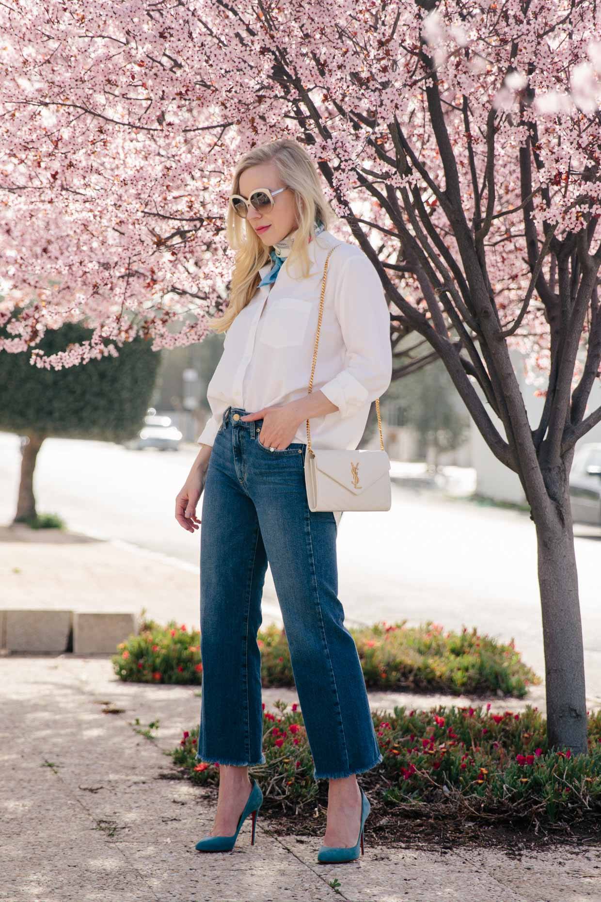 ce8cd6141f3  s Moda wears oversized white button down shirt with wide leg cropped jeans  and Christian Louboutin blue pumps chic spring outfit