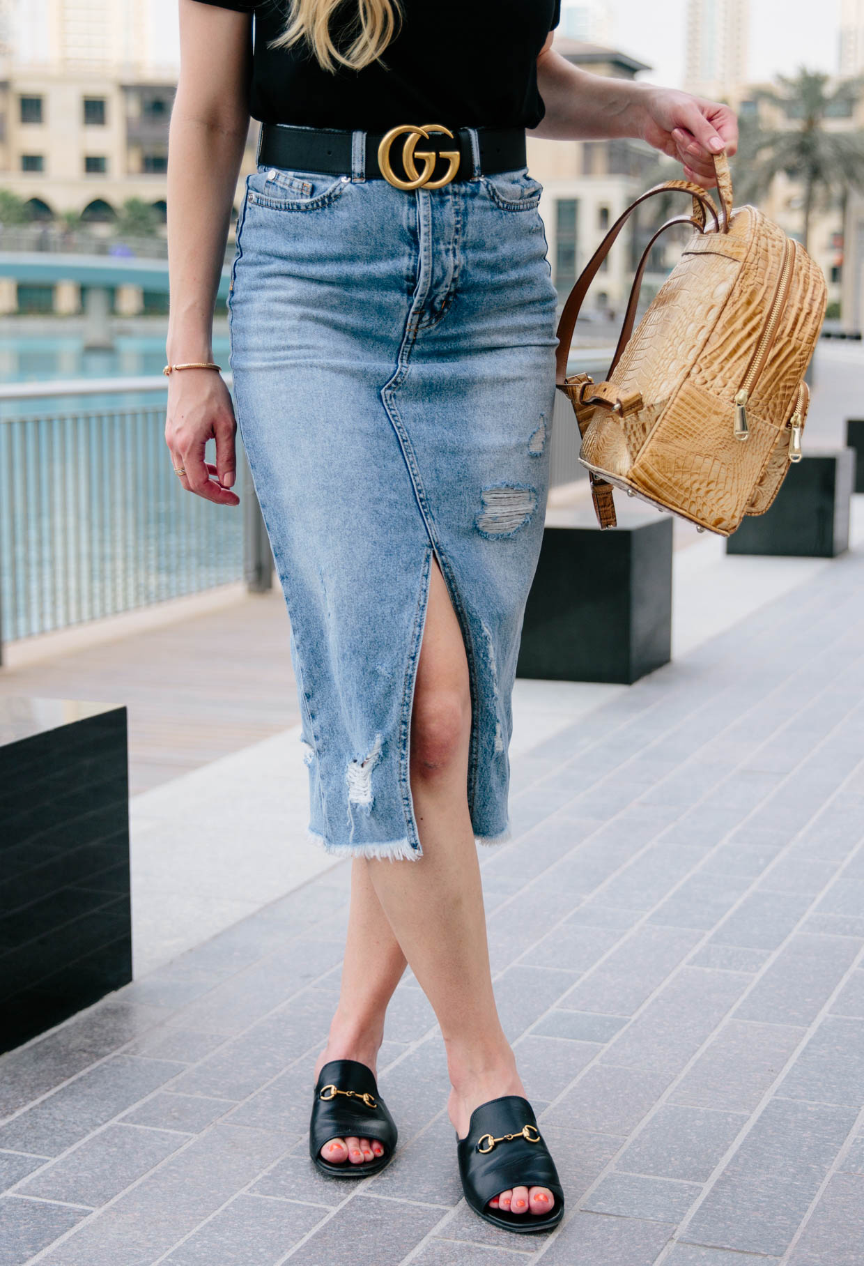 black bodysuit  denim skirt with the burj khalifa