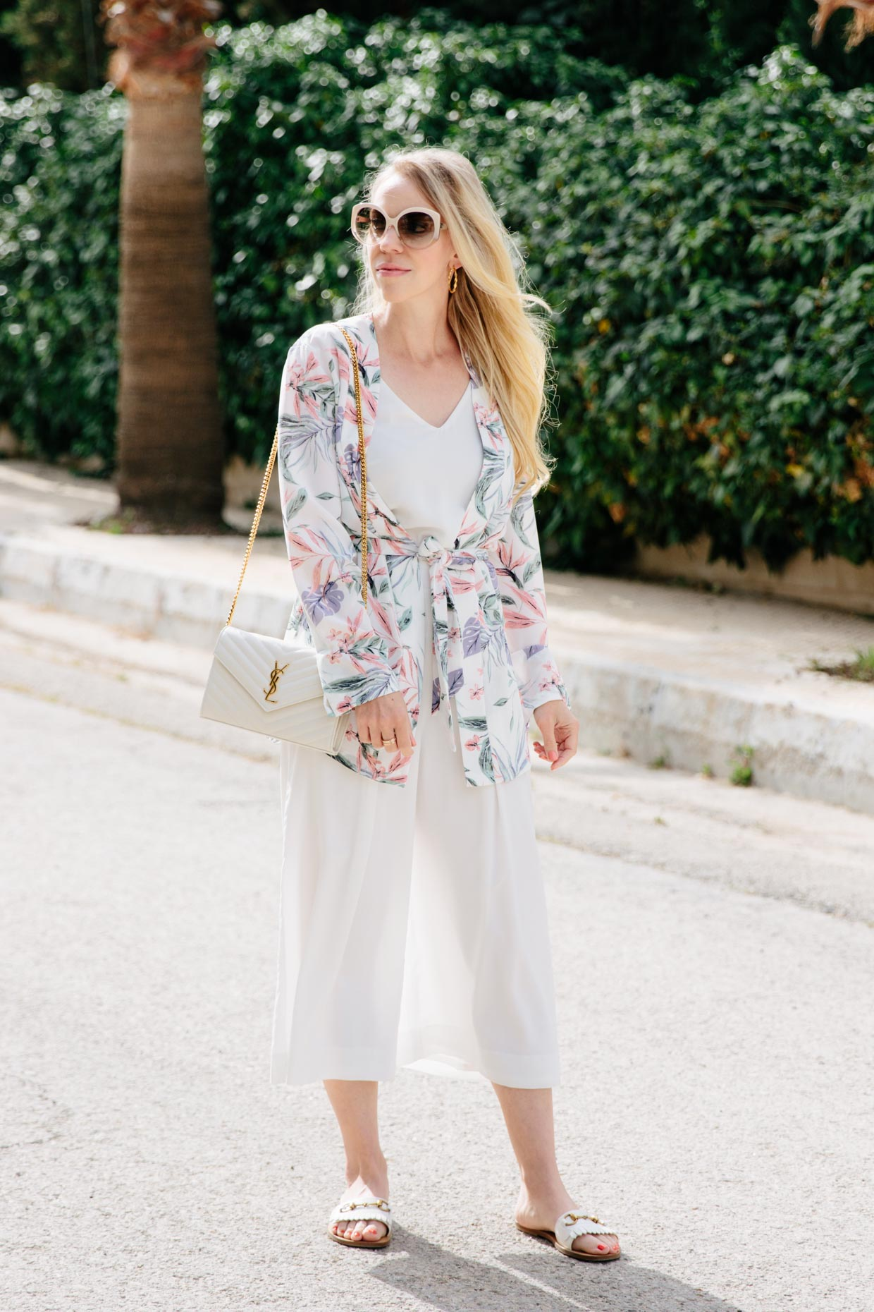 07cf6966e3b Meagan Brandon fashion blogger of Meagan s Moda wears H M tropical print  kimono jacket with white culottes and Gucci slide sandals