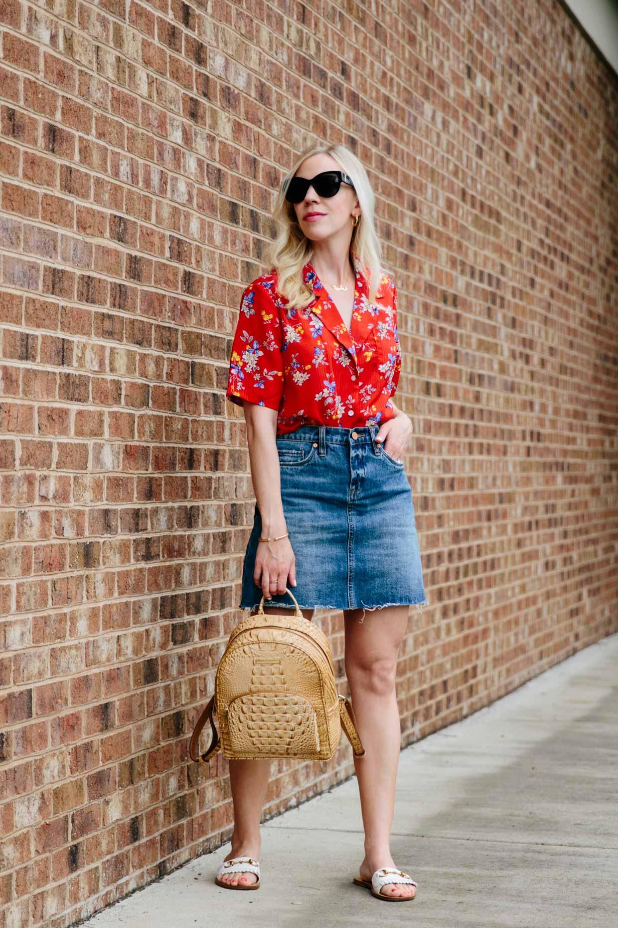 7339d9bf681161 Meagan Brandon fashion blogger of Meagan's Moda wears retro floral print  shirt with denim mini skirt and white Gucci slide sandals, Brahmin Mini  Dartmouth ...