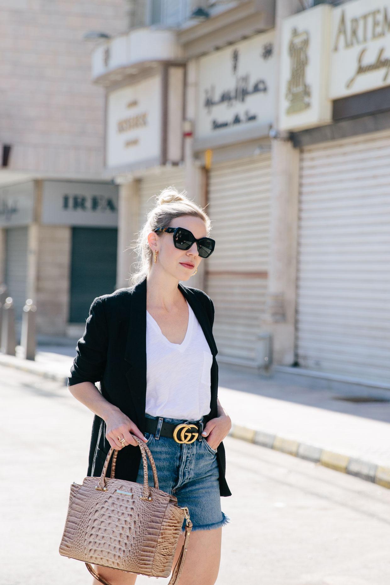 2a058e23fe7 Meagan Brandon fashion blogger of Meagan s Moda shows chic way to wear denim  cutoffs with black blazer