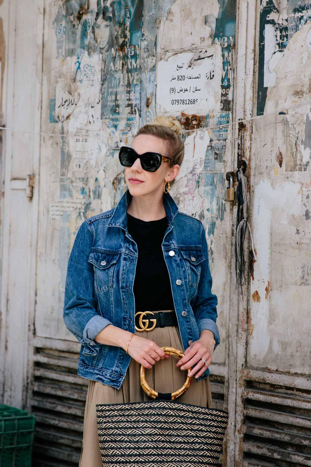 4ad2f993f79 Meagan Brandon fashion blogger of Meagan s Moda wears GAP classic denim  jacket with Gucci belt and pleated skirt